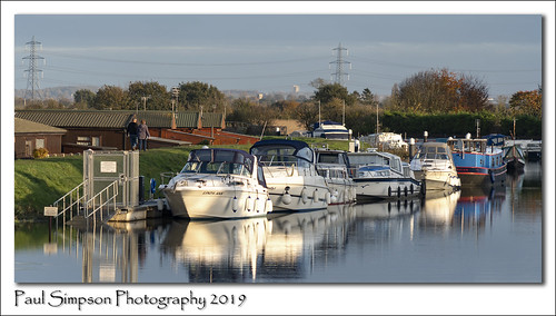 fossdykecanal lincolnshire water river canal boats boat yacht yachts torksey torkseylock waterway transport november2019 paulsimpsonphotography powerlines coupleoutforawalk countryside eastmidlands westlindsey transportnetwork canalboats canalboat waterreflection reflections fossdyke leisure leisuretime england uk lincs