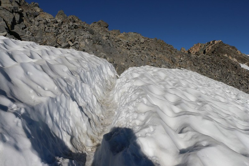The trail to Glen Pass still has a deep trench in the snow even though it is already August