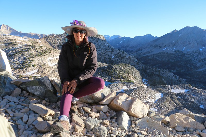 Vicki taking a break on the PCT near Glen Pass with the Rae Lakes Basin in shadow down below to the right