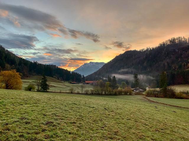 Sunrise on a misty autumn morning in Mühlau near Kiefersfelden, Bavaria, Germany