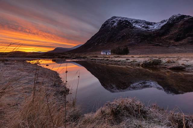 Sunrise at the little white cottage on the banks of the river Coe, Glencoe, Scotland