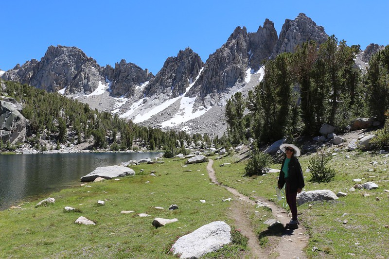 Vicki smiling near one of the Kearsarge Lakes with the Kearsarge Pinnacles behind her