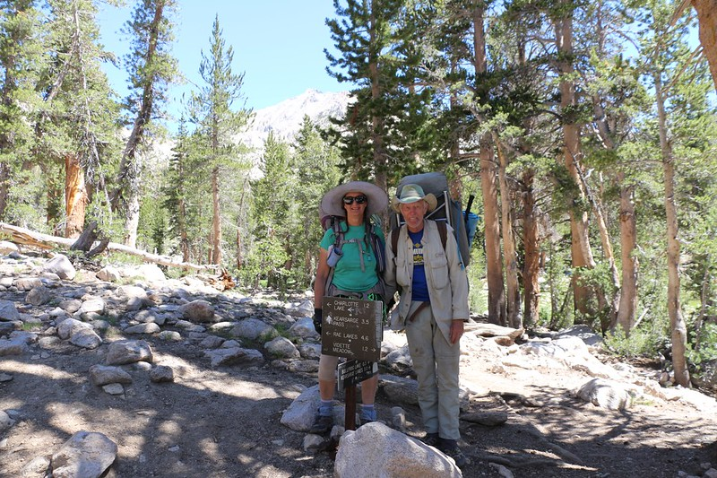 Vicki and I posing with the trail junction signs for the PCT-JMT and the Bullfrog Lake Trail