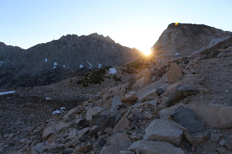The first rays of sun over Painted Lady strike us as we climb toward Glen Pass