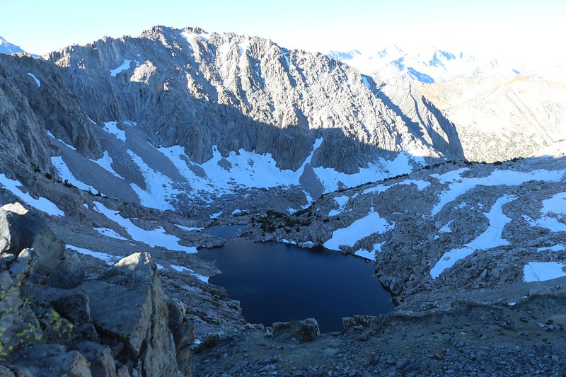 Looking south from Glen Pass at the high lake - the PCT crosses the snow patches on the right side, below
