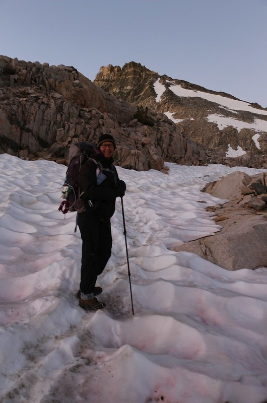 Happy Vicki wearing microspikes and getting excellent traction on the crusty snow near Glen Pass on the PCT