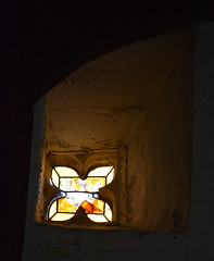 quatrefoil rood light with continental glass of a cockerel and a crown of thorns