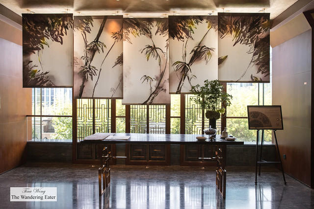 Chinese art walls drape the entry of the Mandarin Oriental Club