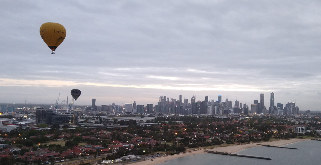 Balloons flying over Port Melbourne towards central Melbourne