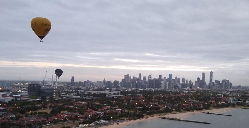 Balloons flying over Port Melbourne towards central Melbourne