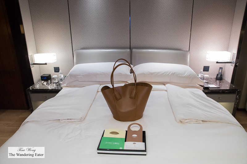 Spacious king bed and my large Bottega Veneta leather tote