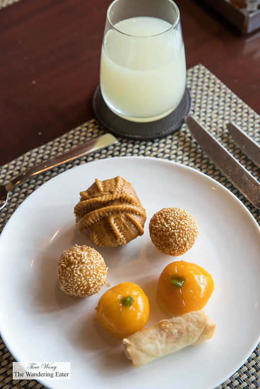 Walnut bun, sesame balls 煎堆, steamed pumpkin dumplings and spring rolls and fresh grapefruit juice for breakfast at the Mandarin Oriental Club lounge