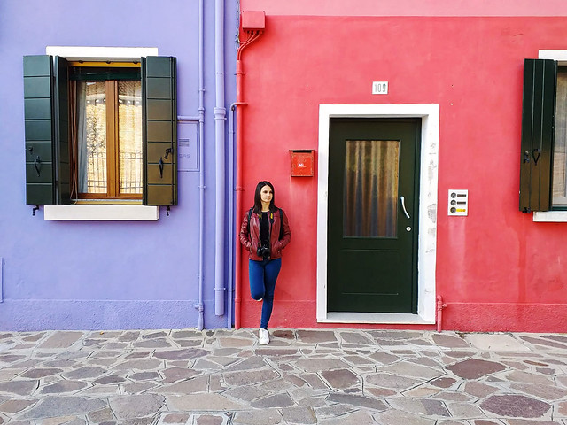Posing between the amazing colorful houses