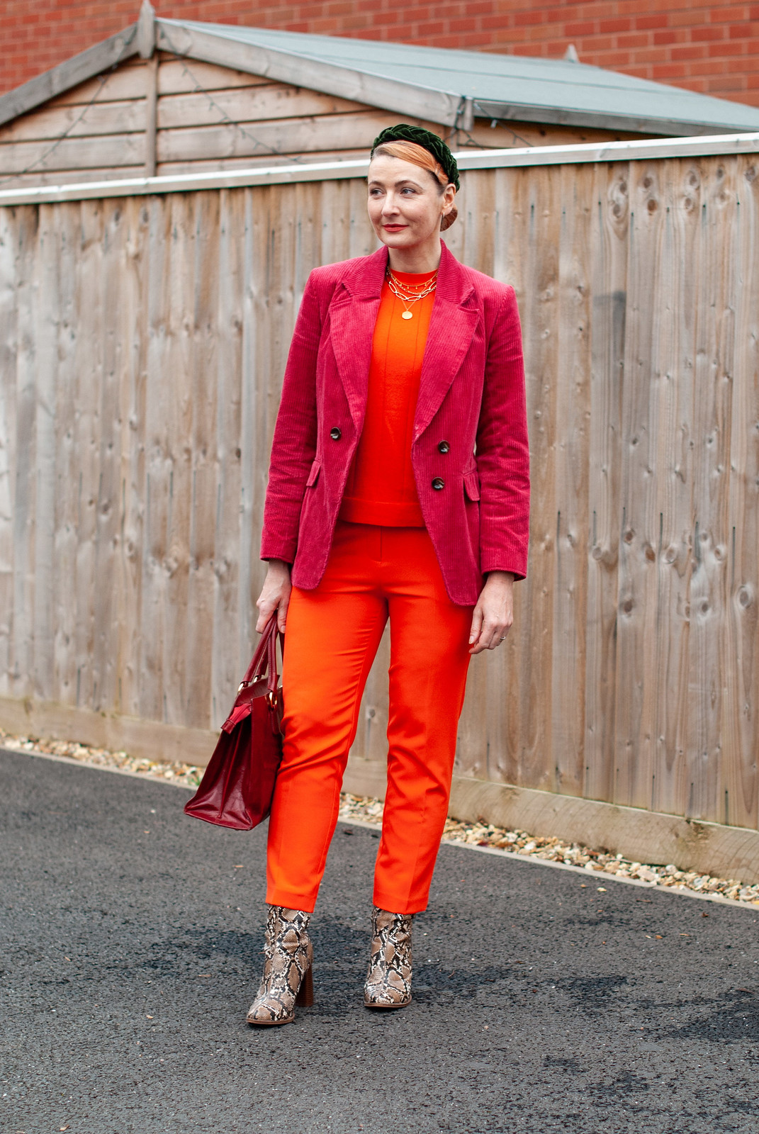 How to Wear Red With Orange: red corduroy blazer, orange sweater, orange tailored trousers, snakeskin boots | Not Dressed As Lamb, over 40 style blog
