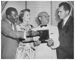Nixons examine King award: 1957
