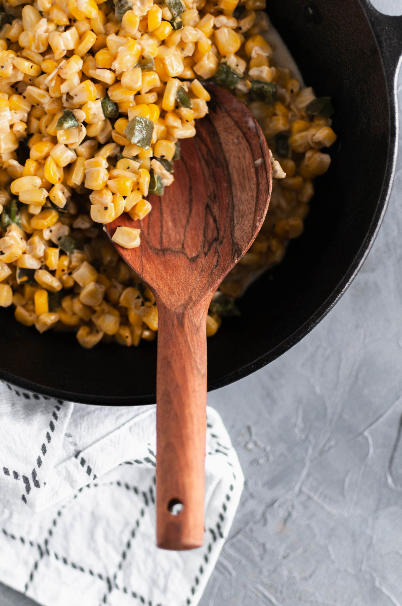 This Jalapeno Cream Corn is slightly spicy, a little sweet and perfectly creamy. It makes a great weeknight side dish or simple holiday option. Made on the stove top with frozen sweet corn, fresh jalapenos, butter and half and half. Ready to serve in minutes.