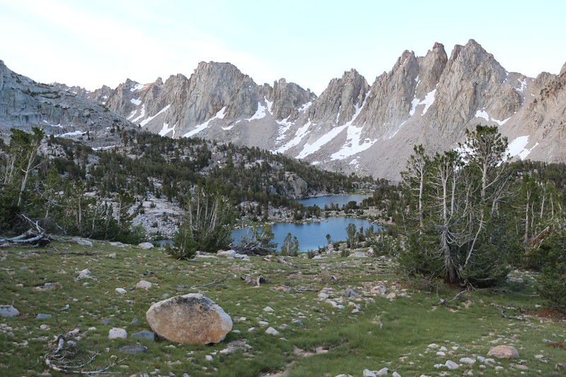 Looking back down at the Kearsarge Lakes from the trail, with the alpenglow on the Kearsarge Pinnacles