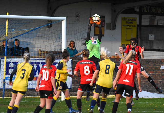 A cross is caught by the Eastbourne Town Women goalkeeper