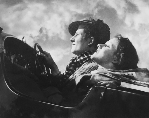 Gordon Crocker, Couple in an open top car, ca. 1934.