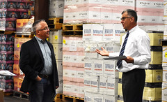 State Rep. Vincent Candelora, left, talks to Robert Sussler Executive Vice President & General Manager at Brescome Barton in North Haven. Brescome Barton is a distributor of spirits, wine and beer.