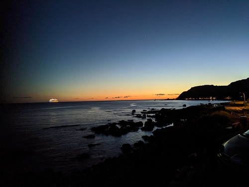 <p>Ovation of the Sea in the foreground cruises on after an issue with it propulsion systems left it stranded in the Wellington heads for an hour or so last evening 18 Nov 2019.</p>