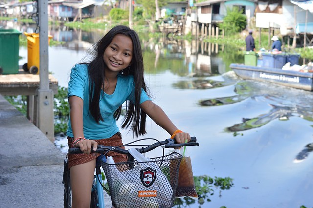 pretty preteen girl on a bicycle