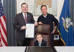 Rep. John Frey, Conner Curran and Governor Ned Lamont pose in the governor's office after he proclaimed World Duchenne Awareness day in Connecticut.   According to the Currans, Duchenne Muscular Dystrophy slowly robs children of the use of their muscles, leading to the necessity of a wheelchair by the age their teenage years, followed by the loss of the use of arm movement to eat or even hug their parents. Eventually, in a child's late twenties, heart and lung muscles start to fail leading to early death.