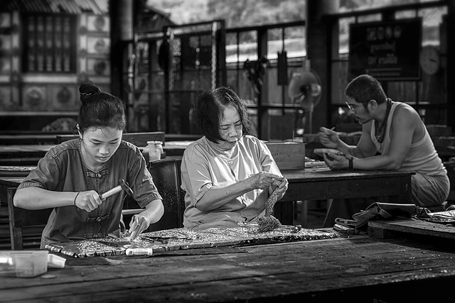 Silverware making. Thai craftman are making silverware. The original of the silver craftsmen on Wua Lai road, Chiang Mai. Thailand