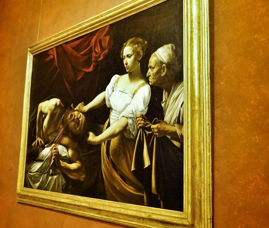 Judit leikkaa Holoferneen pään