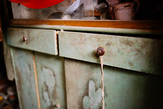 Dirty old wooden green cabinet handles