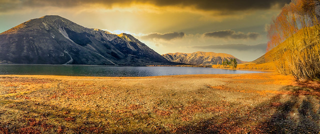 Autumn colours at a peaceful tranquil lake in rural South Island New Zealand
