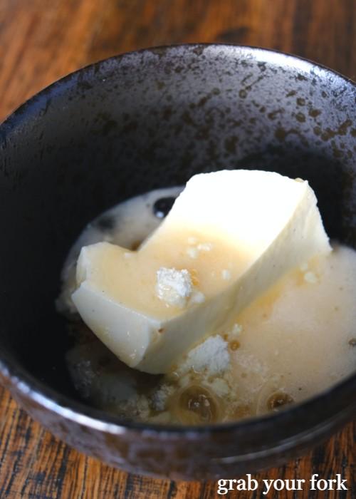 Yoghurt pannacotta with melon and almonds at Noi restaurant in Petersham Sydney