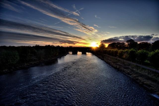 Setting Sun over the railway bridge at Preston