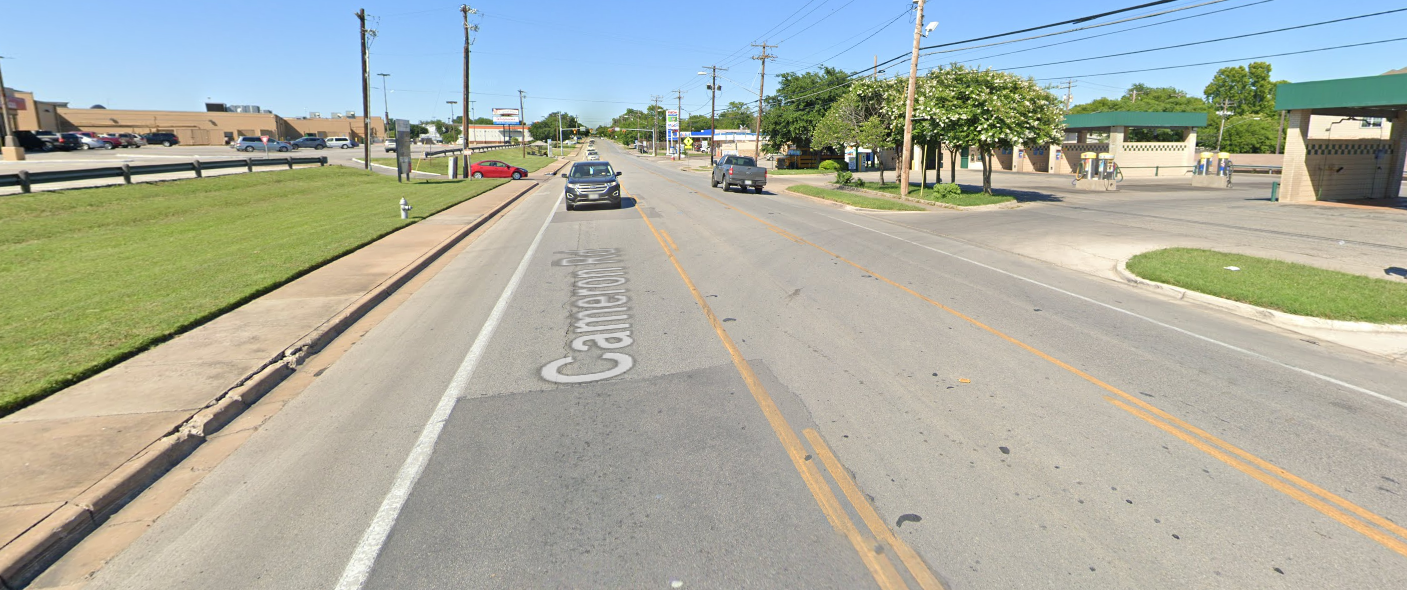 Image of Cameron Road with two travel lanes, center turn lane, and painted bicycle lanes.