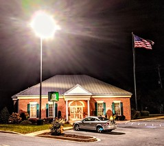 The American flag flies proudly at the New Windsor State Bank at the College Square Shopping Center. 20Nov2019