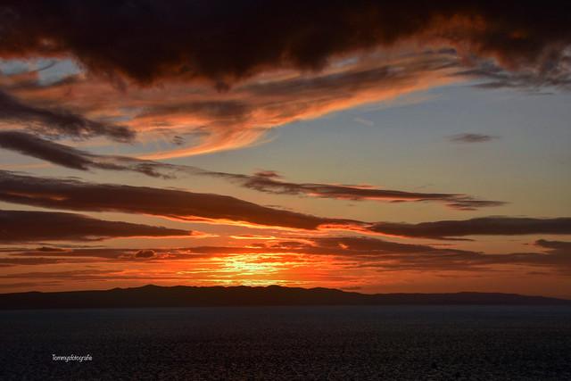 Sunset framed between sea and clouds  Photo taken in Makarska, Croatia