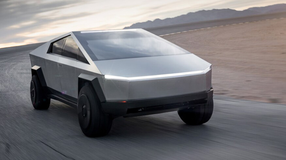 Tesla-Cybertruck-Electric-Pickup-Truck-Front-3-4-in-Motion-on-Road-Course-2