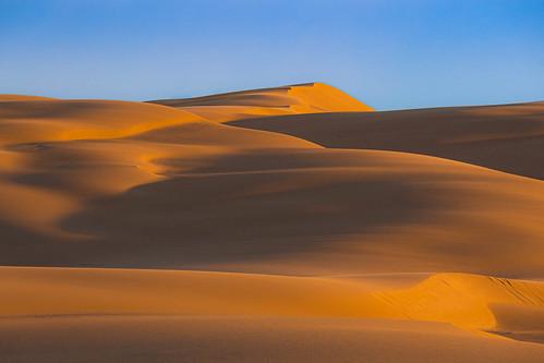 bobsfarm newsouthwales australia blue yellow dawn sunrise stockton beach sand dune anna bay worimi national park birubi