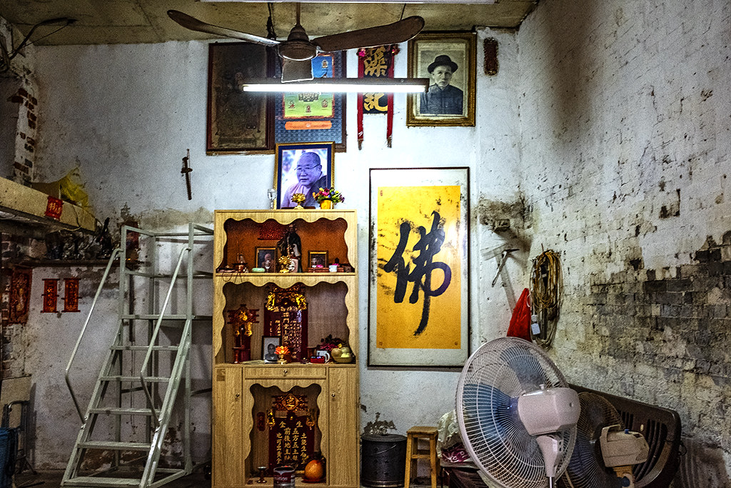 Shrines inside a house in a Cathedral Parish alley--Macau