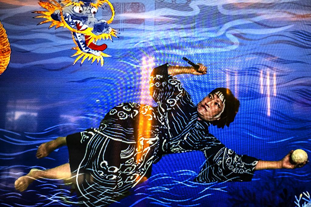 Swimming woman fighting dragon--Macau