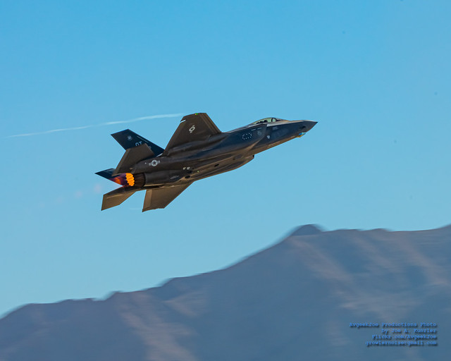 F-35A in Afterburner Racing Along A Valley