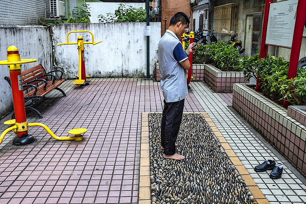 Stone foot therapy in tiny public park--Macau