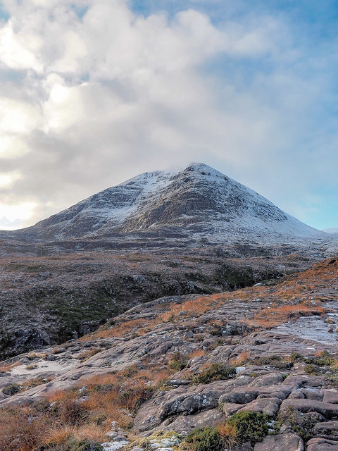 The morning sun catches the ice on Glas Mheall Mor, An Teallach Massif