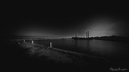 blackandwhite sea sky architecture sunset water nature builtstructure night dusk coastline monochrome nopeople dark cityscape famousplace landscape outdoors cloudsky urbanscene harbour