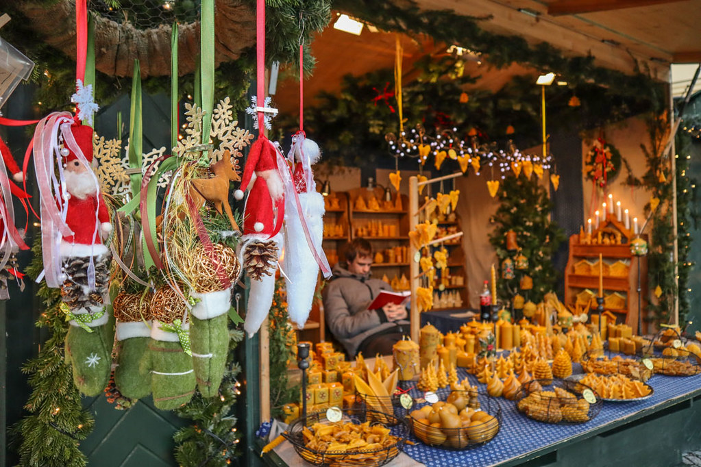 Schoenbrunn Palace Christmas Market, a stall selling candles shaped as cones, Christmas Trees and little angels