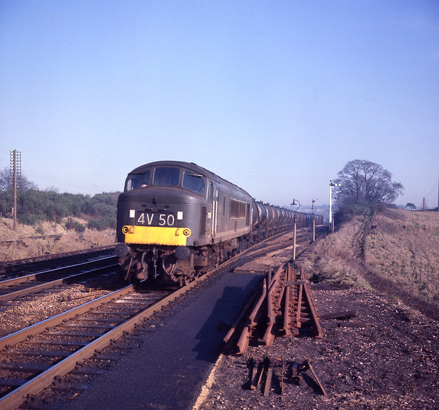 Derby allocated Peak, No. D54, slows through Blackwell station before descending the 1 in 37 Lickey incline with 4V50, the empty Esso oil tanks from Bromford Bridge to Avonmouth.