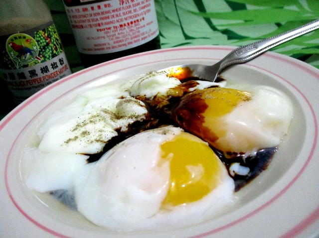 Half boiled eggs with soy sauce & pepper