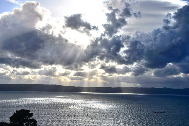 Skyscape, cloudscape and seascape over the Adriatic Sea, Photo taken from driving car near Igrane, Croatia