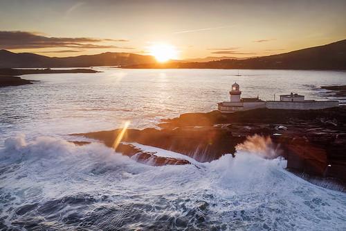 valentia island kerry countykerry atlantic ocean waves sea rocks light lighthouse ireland sun sunrise wildatlanticway