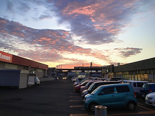 24november2019 edited kitahiroshima hokkaido japan train jrhokkaido localtrain railcrossing parkinglot grocerystore sunset clouds sky cars